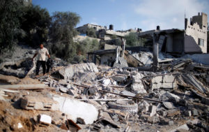 A Palestinian man inspects a Hamas site that was hit in an Israeli air strike, in Al-Mughraqa on the outskirts of Gaza City on Aug. 9. Photo by Mohammed Salem/Reuters