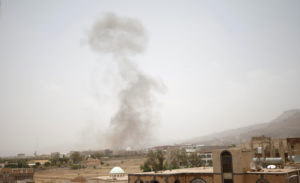 Smoke rises after an airstrike in Sanaa, Yemen on Aug. 9. Photo by Mohamed al-Sayaghi/Reuters