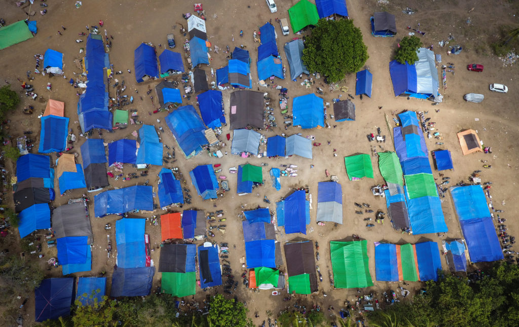 Aerial view of tents for displaced and homeless earthquake victims in Sigar Penjalin village, North Lombok, Indonesia August 10, 2018. Photo by Antara Foto/Ahmad Subaid/Reuters