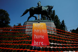 "A sign reading ""Hate Has No Home Here"" hangs by the statue of Civil War Confederate General Robert E. Lee in Charlottesville, Virginia. Taylor Dumpson is seeking damages against the founder of The Daily Stormer after the neo-Nazi website launched a harassment campaign against her. The site previously posted a post that mock the woman who was killed by a man who drive his car into a crowd of counterprotesters at the 2017 white nationalist rally in Charlottesville. Photo by Brian Snyder/Reuters"