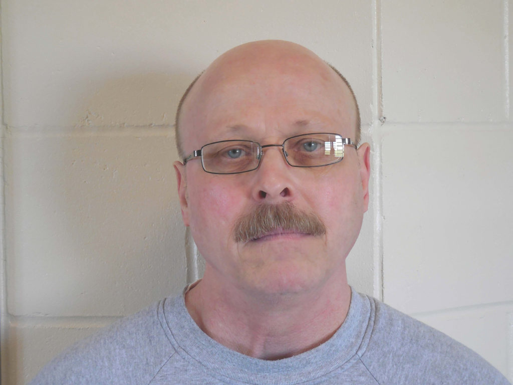 Carey Dean Moore, 60, appears in a police booking photo released in Lincoln, by the Nebraska Department of Correctional Services. Photo by Nebraska Department of Correctional Services via Reuters