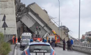 Rescue workers are seen at the collapsed Morandi Bridge in the Italian port city of Genoa on Aug. 14 in this still image taken from a video. Local Team via Reuters TV