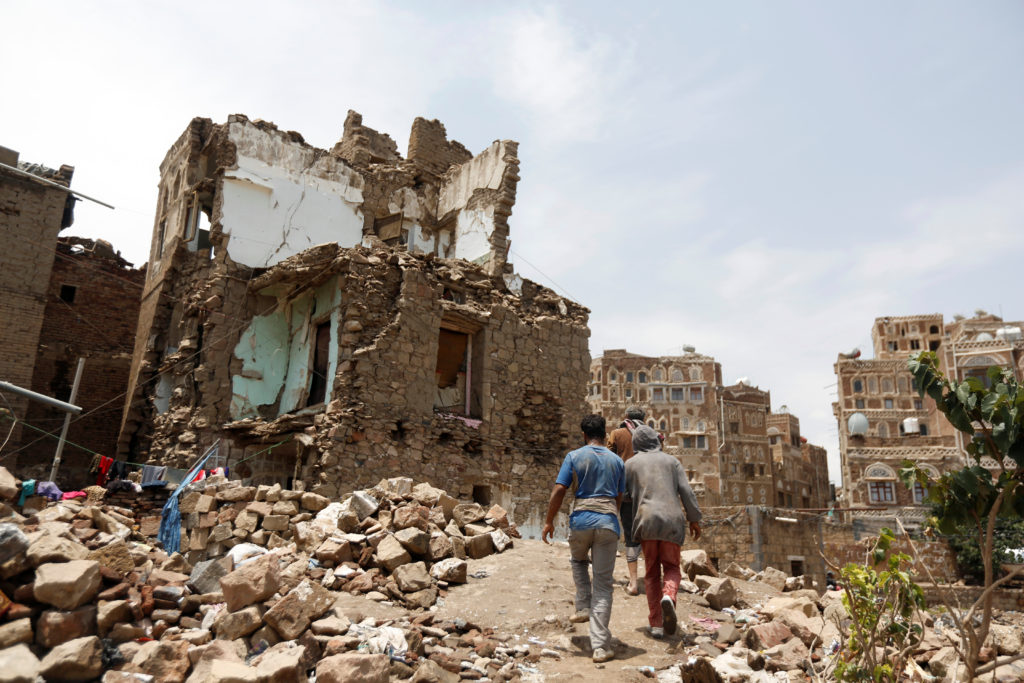 Damage caused by an airstrike in the old quarter of Sanaa, Yemen on Aug. 8. Photo by Khaled Abdullah/Reuters