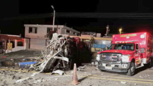 The wreckage of the bus is seen in Papallacta, Ecuador on Aug. 13 in this image obtained from social media by Reuters on Aug. 14.