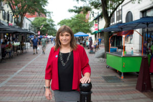 Vermont Democratic Party gubernatorial primary candidate Christine Hallquist, a transgender woman, poses as she campaigns on Church Street in Burlington, Vermont. Photo by Caleb Kenna/Reuters