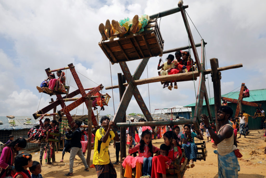 Rohingya refugee children ride a human-powered Ferris wheel on Eid al-Adha in the Kutupalong refugee camp in Cox's Bazar, Bangladesh, on Aug. 22. Photo by Mohammad Ponir Hossain/Reuters