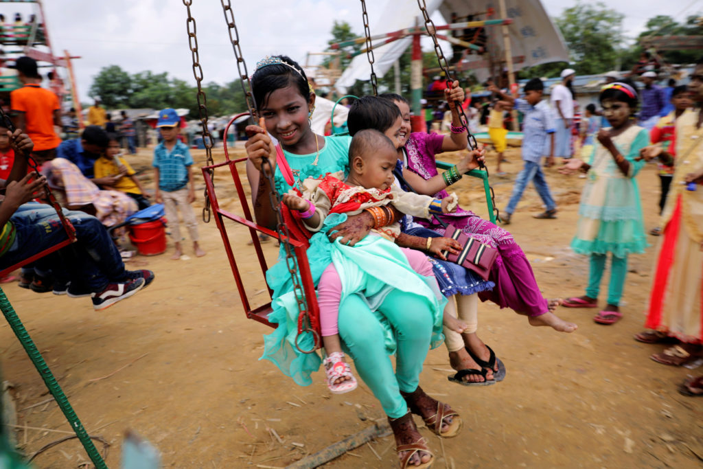 Rohingya refugee children take a swing ride on the holiday Eid al-A…