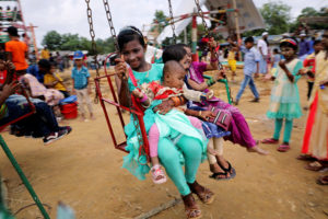 Rohingya refugee children take a swing ride on the holiday Eid al-Adha in the Kutupalong refugee camp in Cox's Bazar, Bangladesh, on Aug. 22. Photo by Mohammad Ponir Hossain/Reuters