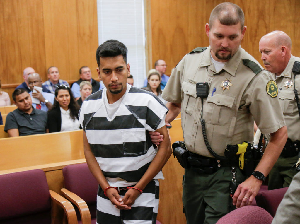 Cristhian Rivera, 24, accused of killing University of Iowa student Mollie Tibbetts, is led from the courtroom after making his initial appearance on a charge of first-degree murder during at the Poweshiek County Courthouse in Montezuma, Iowa, U.S., August 22, 2018. Jim Slosiarek/The Gazette/Pool via REUTERS - RC1718341720