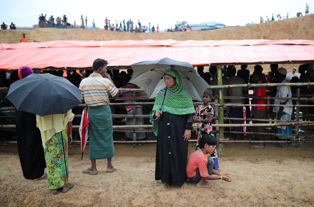 Rohingya refugees line up for meat from a relief distribution center in the Balukhali refugee camp in Cox's Bazar, Bangladesh. The refugees are dependent on aid agencies for all of their food. Photo by Mohammad Ponir Hossain/Reuters