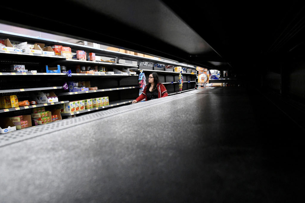 Nina Roberts shops for last minute supplies while shelves remain empty as Hurricane Lane approaches Honolulu, Hawaii. Photo by Hugh Gentry/Reuters