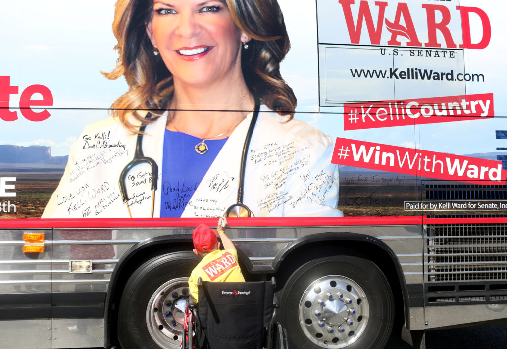 A supporter signs Kelli Ward's campaign bus as Ward appears at the Gunsite academy in her bid to become the Republican nominee for an open Senate seat in Paulden, Arizona, U.S. August 24, 2018. REUTERS/Conor Ralph - RC16B3D2A400