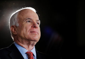 Republican presidential nominee Senator John McCain (R-Ariz.) listens as he is being introduced at a campaign rally in Denver, Colorado. Photo by Brian Snyder/Reuters