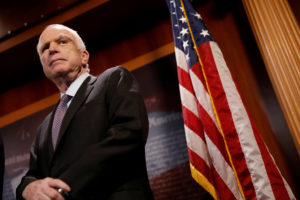 "Sen. John McCain (R-Ariz.) looks on during a press conference about his resistance to the so-called ""Skinny Repeal"" of the Affordable Care Act on Capitol Hill in Washington, D.C. Photo by Aaron P. Bernstein/Reuters"