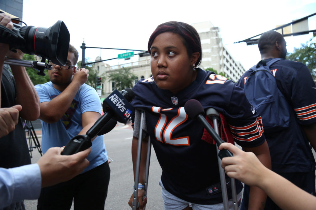 Taylor Poindexter speaks to reporters after witnessing a gunman open fire on gamers participating in a video game tournament outside The Jacksonville Landing in Jacksonville, Florida. Photo by Joey Roulette/Reuters