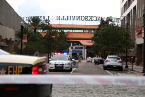 Police officers cordon off a street outside The Jacksonville Landing after a shooting during a video game tournament in Jacksonville, Florida. Photo by Joey Roulette/Reuters