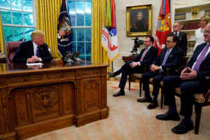 President Donald Trump speaks with Mexican representatives in trade negotiations at the White House on Aug. 27. Photo by Kevin Lamarque/Reuters
