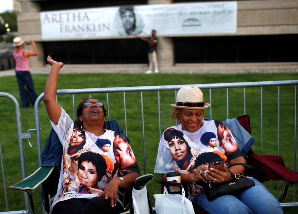People wait in line outside the Charles H. Wright Museum of African American History where the late singer Aretha Franklin will lie in state for two days of public viewing in Detroit, Michigan. Photo by Mike Segar/Reuters
