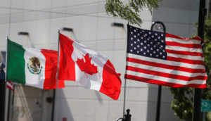 Flags of the U.S., Canada and Mexico fly next to each other in Detroit, Michigan, U.S. August 29, 2018. REUTERS/Rebecca Cook