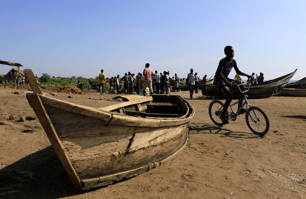 A bicyclist rides through Panyimur fishing village, about 250 miles north of Uganda's capital Kampala. Photo by James Akena/Reuters