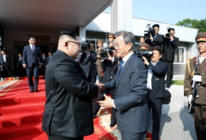 South Korean President Moon Jae-in shakes hands with North Korean leader Kim Jong Un as he leaves after their summit at the truce village of Panmunjom, North Korea, in this handout picture provided by the Presidential Blue House on May 26, 2018. Photo by The Presidential Blue House via Reuters
