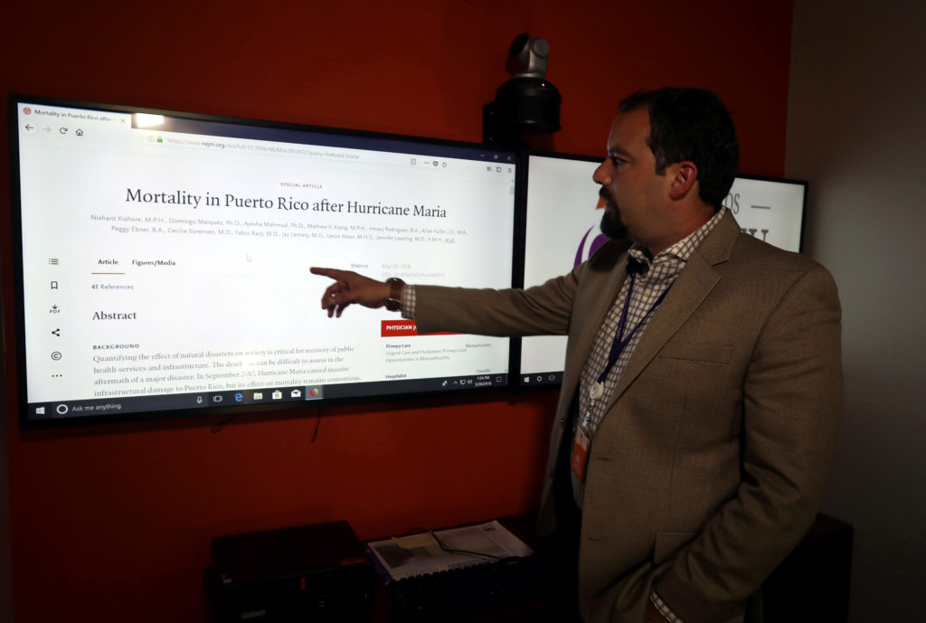 Domingo Marquez, associate professor at the University of Carlos Albizu and member of a research team led by Harvard University, talks to Reuters about Hurricane Maria claiming the lives of 4,645 people and not the 64 long pegged by the island's government as the official death toll, in San Juan, Puerto Rico May 30, 2018. REUTERS/Alvin Baez - RC1537DB4E70