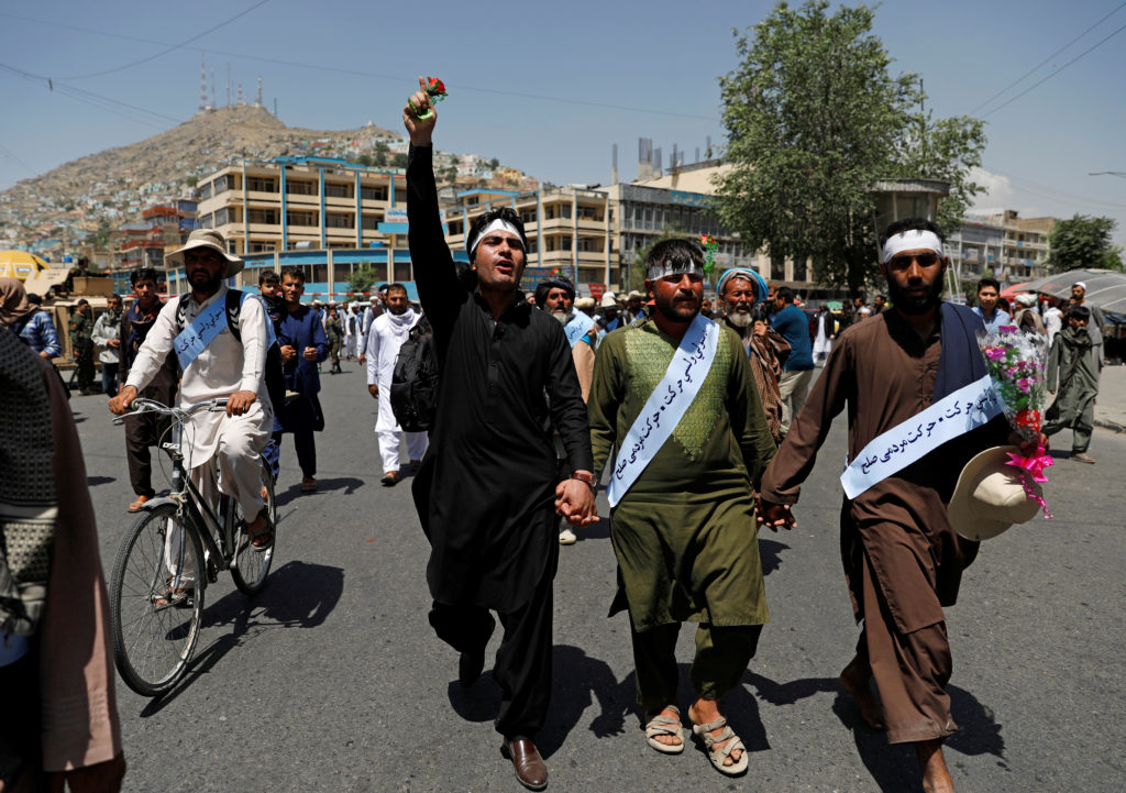 Members of the Taliban, soldiers and civilians mingled on the streets of Kabul, Afghanistan during the temporary cease-fir...