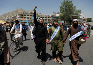 Members of the Taliban, soldiers and civilians mingled on the streets of Kabul, Afghanistan during the temporary cease-fire in June. Photo by Mohammad Ismail/Reuters