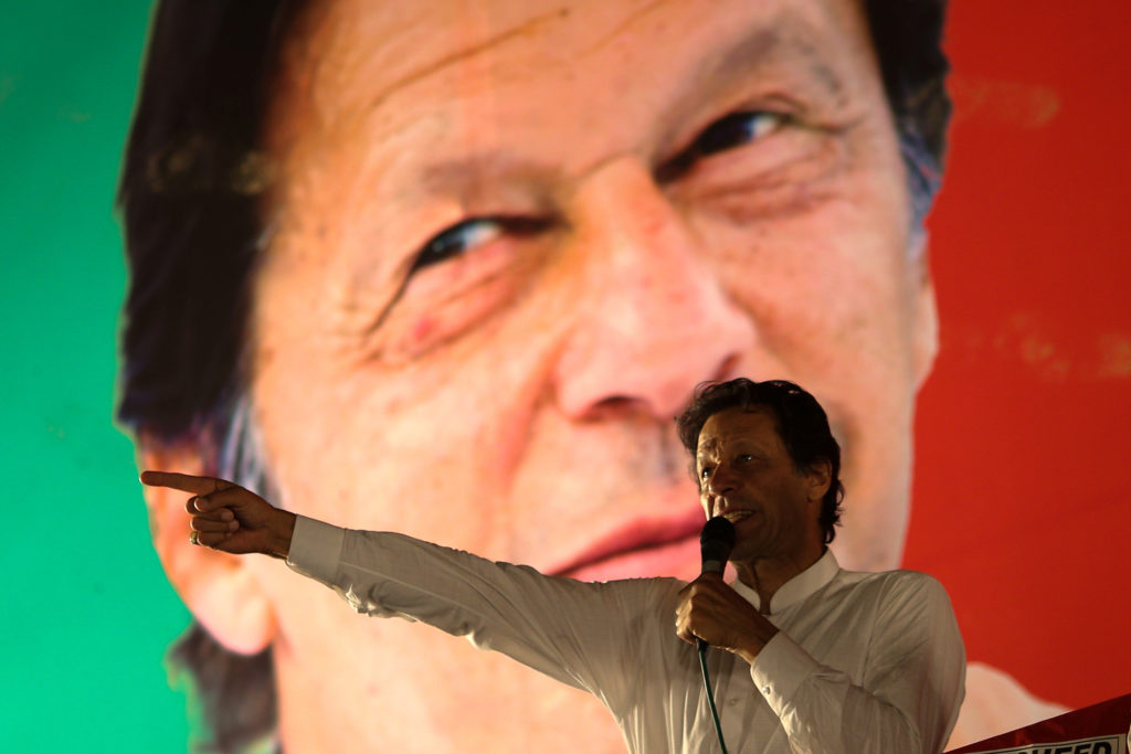 Imran Khan, chairman of the Pakistan Tehreek-e-Insaf (PTI) gestures while addressing his supporters during a July campaign meeting ahead of general elections in Islamabad, Pakistan. Photo by Athit Perawongmetha/Reuters