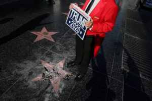 Greg Donovan, 58, stands on President Donald Trump's vandalized star on the Hollywood Walk of Fame in Hollywood, Los Angeles, California. Photo by Lucy Nicholson/Reuters
