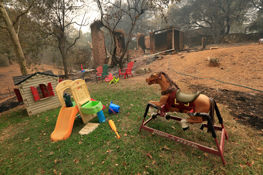 Toys stand untouched near a home destroyed by the Carr Fire west of Redding, California. Photo by Bob Strong/Reutes