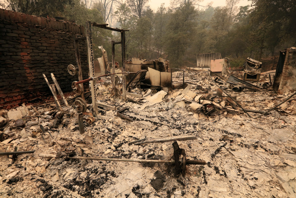 The debris of a burned home is seen after the Carr Fire west of Redding, California. Photo by Bob Strong/Reuters
