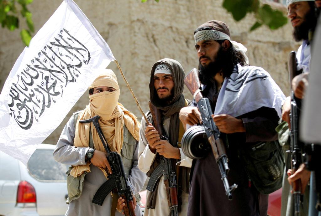 Taliban walk as they celebrate ceasefire in Ghanikhel district of Nangarhar province, Afghanistan. Photo by Parwiz/Reuters