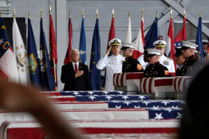Vice President Mike Pence and Admiral Phil Davidson, U.S. Indo-Pacific Commander, honor the remains of U.S. soldiers from the Korean War at Joint Base Pearl Harbor-Hickam in Honolulu, Hawaii, U.S., August 1, 2018. REUTERS/Hugh Gentry