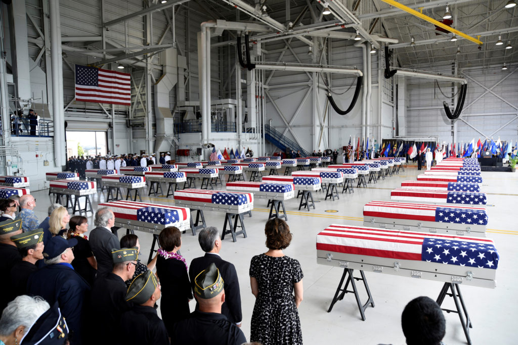 Caskets containing the remains of American servicemen from the Korean War are lined up in Honolulu. Photo by Hugh Gentry/Reuters