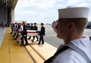 Caskets containing the remains of American servicemen from the Korean War handed over by North Korea arrive at Joint Base Pearl Harbor-Hickam in Honolulu, Hawaii, on Aug. 1. Photo by Hugh Gentry/Reuters