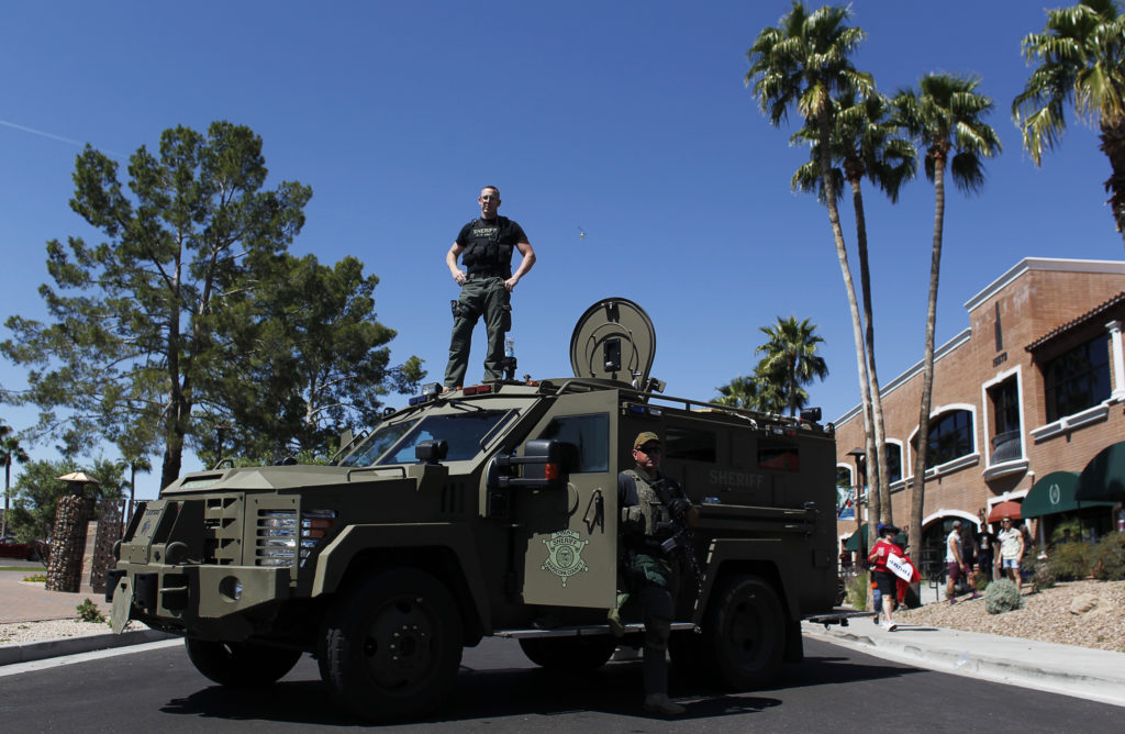 Maricopa County, Arizona police SWAT team with an armored vehicle stand guard outside a campaign rally being held by Republican U.S. presidential candidate Donald Trump in Fountain Hills, Arizona March 19, 2016. Photo by REUTERS/Ricardo Arduengo