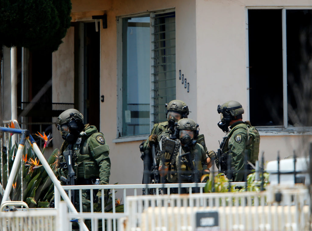 A police SWAT team leaves a home they had surrounded while searching for a second suspect after a San Diego police officer was fatally shot and another was wounded late on Thursday, in San Diego, California, United States July 29, 2016.   Photo by REUTERS/Mike Blake