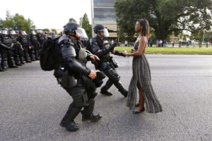 Lone activist Ieshia Evans stands her ground while offering her hands for arrest as she is charged by riot police during a protest against police brutality outside the Baton Rouge Police Department in Louisiana, USA, 9 July 2016. Photo by REUTERS/Jonathan Bachman