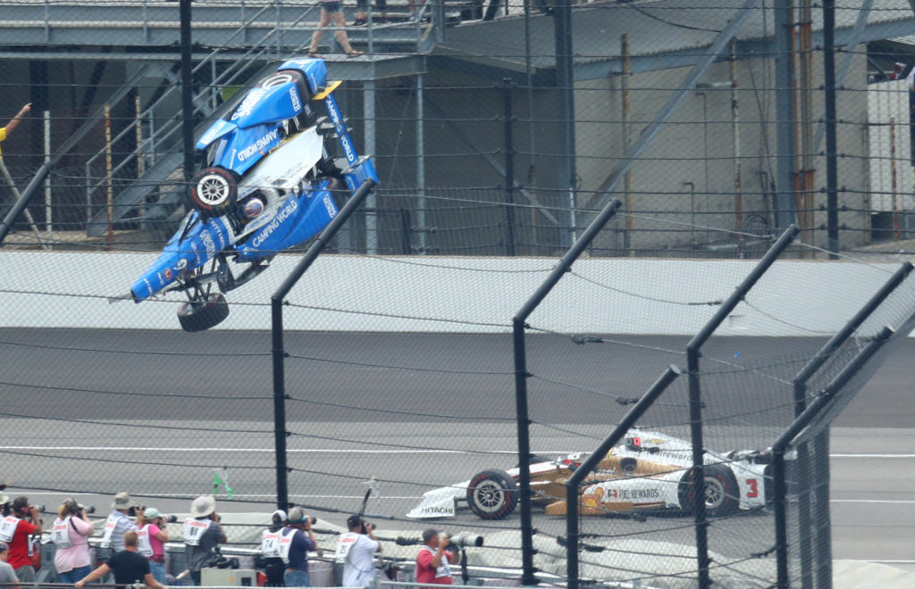 IndyCar Series driver Scott Dixon (9) goes airborne and crashes in front of Helio Castroneves (3) during the 101st Running of the Indianapolis 500 at Indianapolis Motor Speedway. Photo by Mark J. Rebilas-USA TODAY Sports