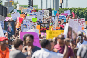 Thousands of activists shut down the Dan Ryan Expressway lead by Rev. Michael Pfleger from Saint Sabina Catholic Church to protest gun violence on July 7, 2018, in Chicago, IL. (Photo by Patrick Gorski/NurPhoto via Getty Images)