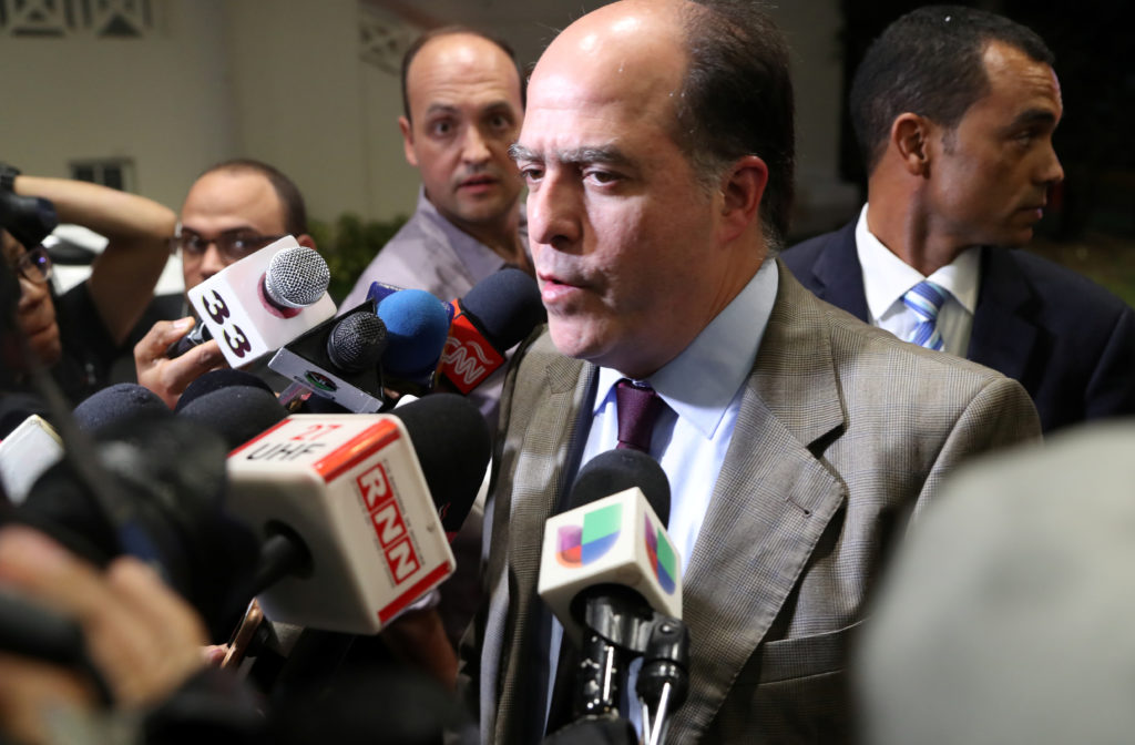 Julio Borges, lawmaker of the Venezuelan coalition of opposition parties (MUD), talks to the media before he attends Venez...