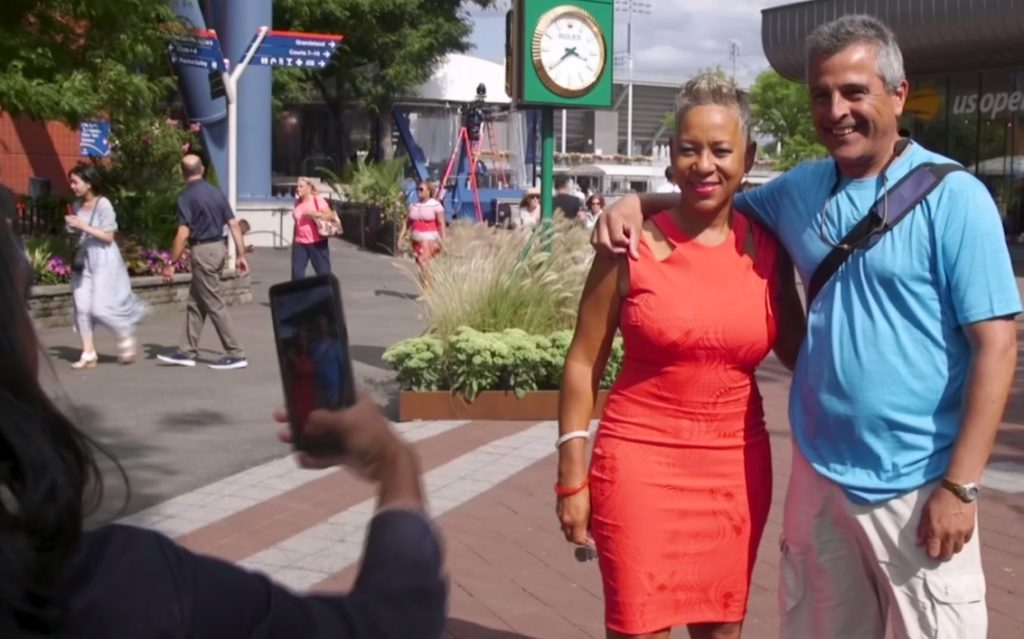USTA President Katrina Adams poses for a picture with a fan. Photo by PBS NewsHour Weekend
