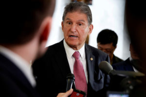 "FILE PHOTO: Senator Joe Manchin (D-WV) speaks to the media as he arrives for a Senate Intelligence Committee hearing evaluating the Intelligence Community Assessment on ""Russian Activities and Intentions in Recent US Elections"" on Capitol Hill in Washington, U.S., May 16, 2018. REUTERS/Joshua Roberts/File Photo"