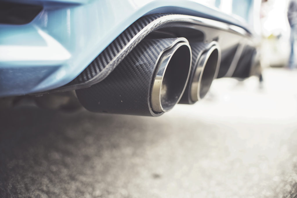Double exhaust pipes of a modern sports car. Photo by irontrybex/via Adobe Stock