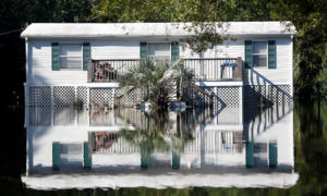 Water from the flooded Waccamaw River surrounds a house in the aftermath of Hurricane Florence now downgraded to a tropical depression in Conway, South Carolina, U.S. September 19, 2018. Photo by Randall Hill/Reuters