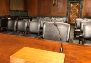 The witness table in the U.S. Senate Judiciary Committee hearing room where Dr. Christine Blasey Ford and U.S. Supreme Court nominee Judge Brett Kavanaugh will testify is seen on Capitol Hill in Washington, U.S., September 26, 2018. REUTERS/Jim Bourg