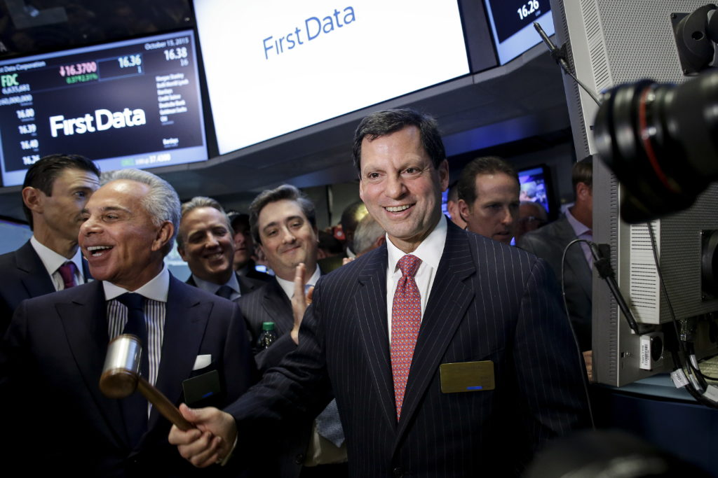 First Data Chairman and Chief Executive Frank Bisignano rings a bell to signal the start of trading after his company's initial public offering on the floor of the New York Stock Exchange October 15, 2015. Bisignano's total compensation in 2017 was $102 million, the overwhelming majority coming from stocks. REUTERS/Brendan McDermid