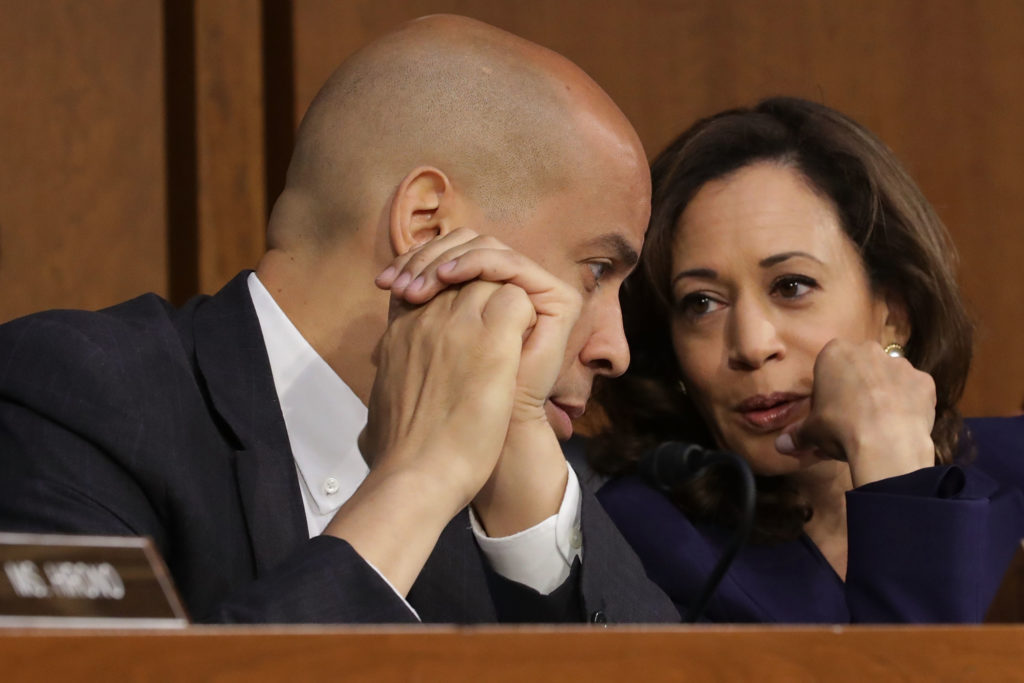 WASHINGTON, DC - SEPTEMBER 05:  Senate Judiciary Committee members Sen. Cory Booker (D-NJ) (L) and Sen. Kamala Harris (D-CA) confer as Supreme Court nominee Judge Brett Kavanaugh testifies before the committee the second day of his Supreme Court confirmation hearing on Capitol Hill September 5, 2018 in Washington, DC. Kavanaugh was nominated by President Donald Trump to fill the vacancy on the court left by retiring Associate Justice Anthony Kennedy.  (Photo by Chip Somodevilla/Getty Images)