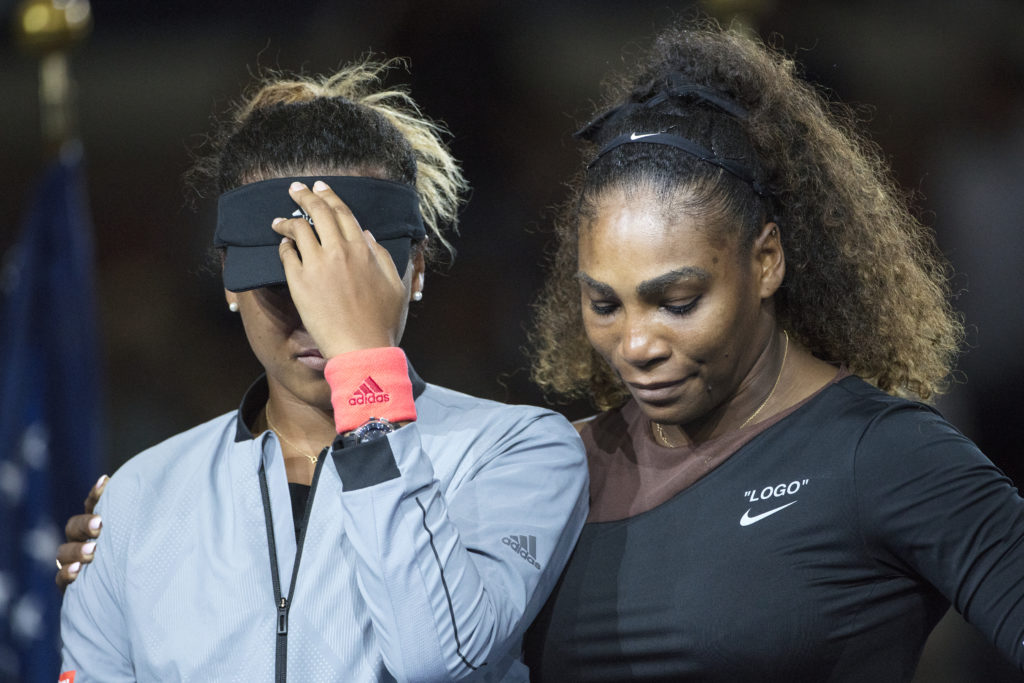 Serena Williams of the United States embrace Naomi Osaka of Japan as she cries at the presentations after the controversial Women's Singles Final on Arthur Ashe Stadium at the 2018 U.S. Open Tennis Tournament in Flushing, Queens, New York City. Photo by Tim Clayton/Corbis via Getty Images